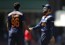 Navdeep Saini and Virat Kohli