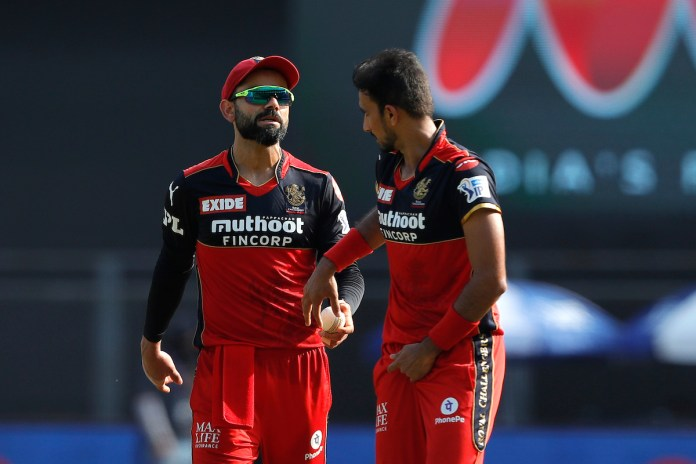 Virat Kohli with Avesh Khan