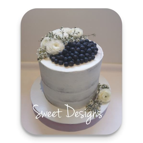 Naked Birthday Cake with blueberries and Fresh flowers