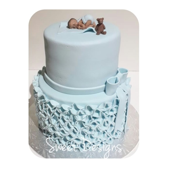 Baby Shower Cake with little baby and bear topper. Ruffle bottom.