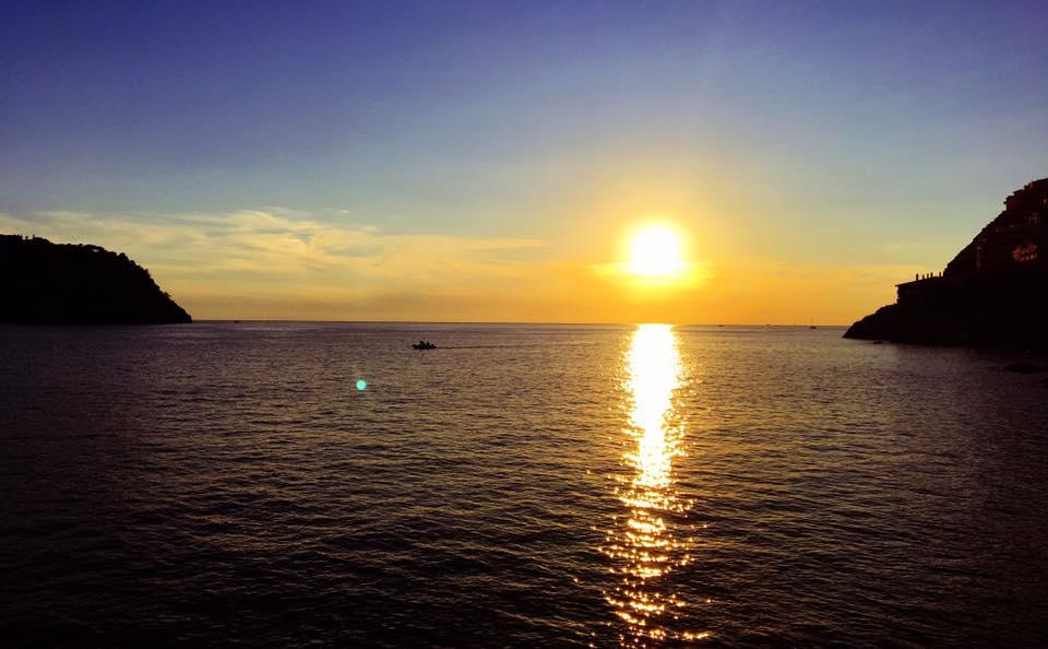 sunset vinyasa yoga at the red lighthouse of Port d'Andratx
