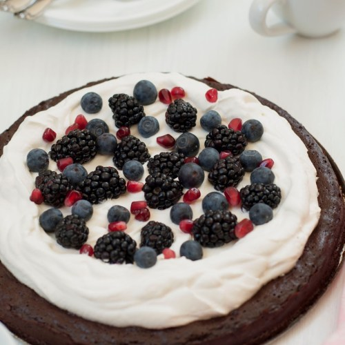 Flourless Chocolate Honey Cake with Berries and Whipping Cream