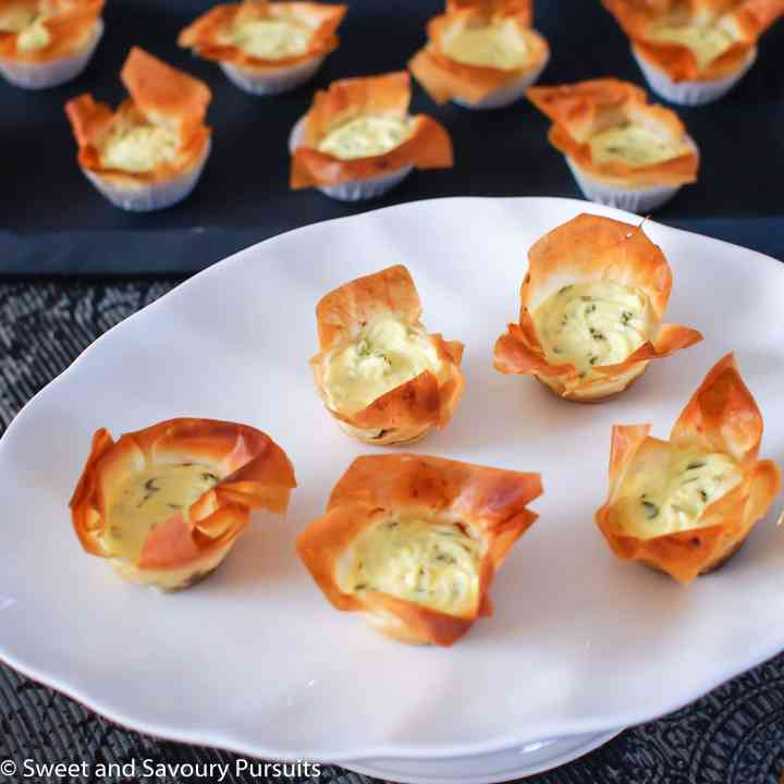 Caramelized Onion and Goat Cheese Phyllo Tartelettes on dish.