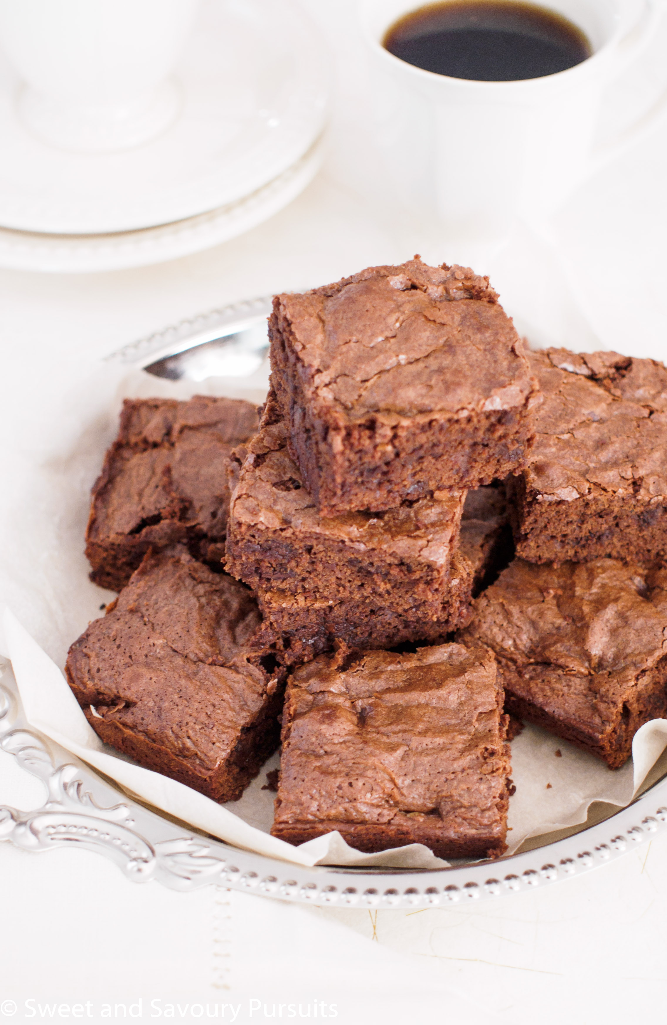 Dish of stacked Triple Chocolate Brownies