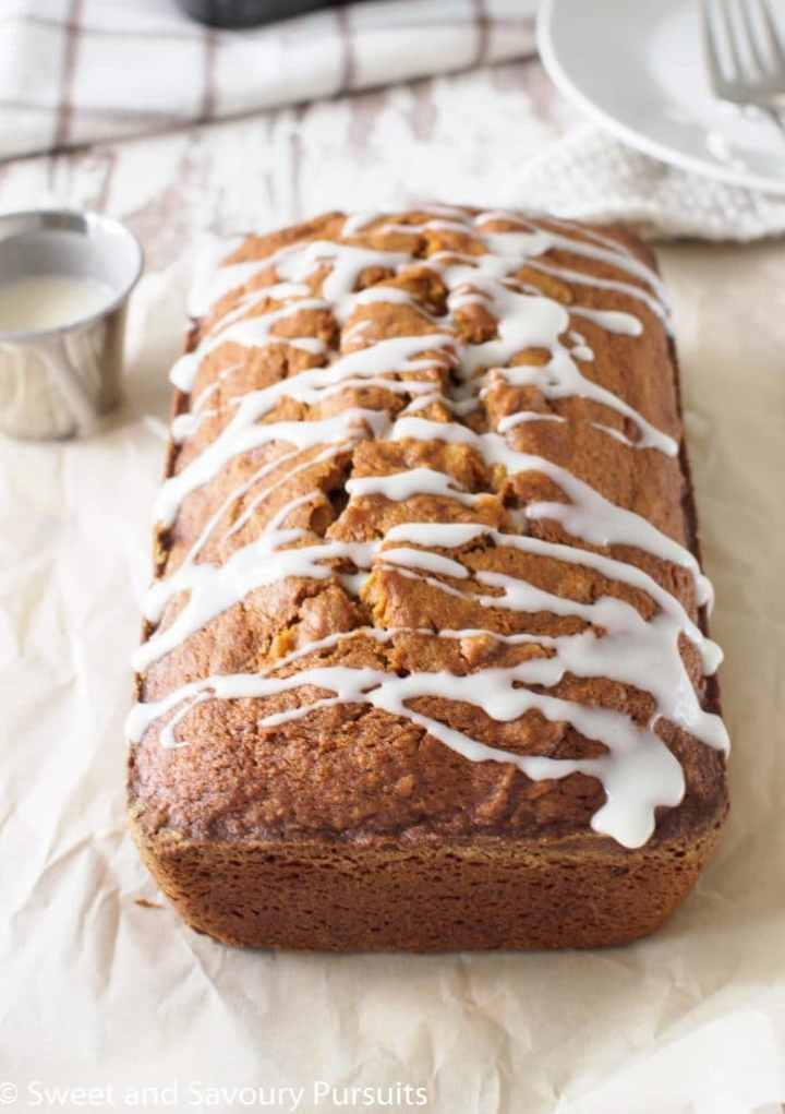 Pumpkin Walnut Loaf with drizzle of icing.