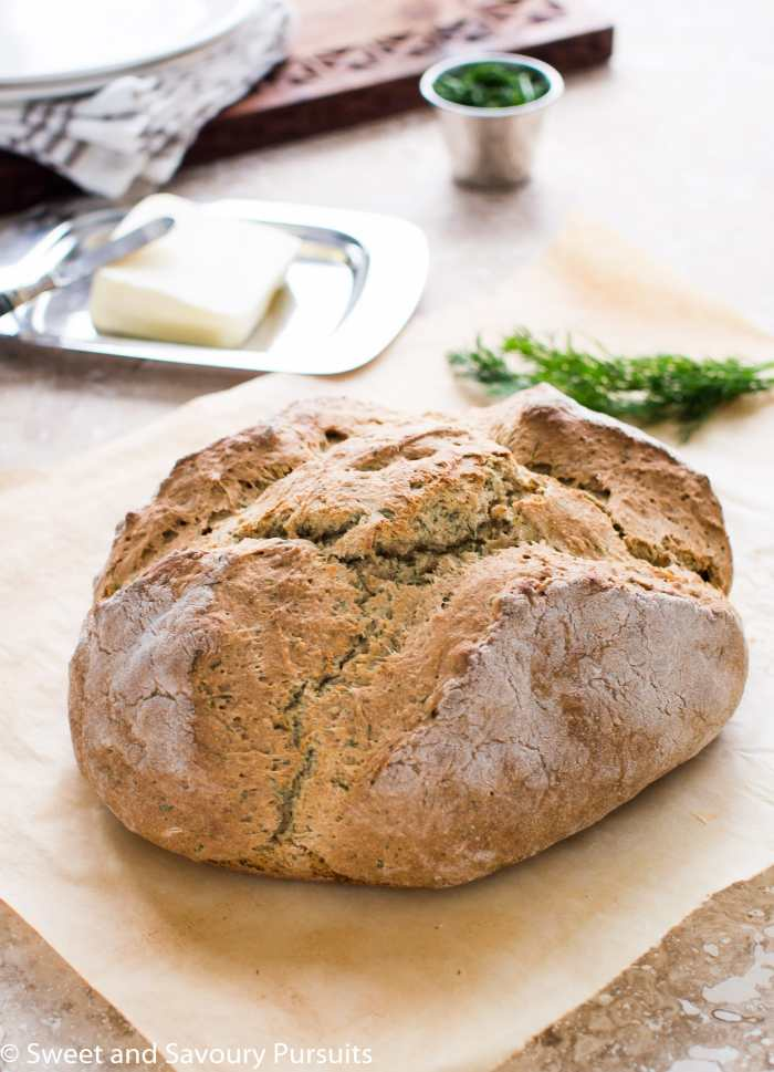 Loaf of Irish Soda Bread with Dill on parchment paper