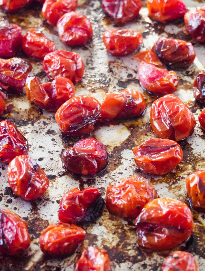 Roasted Grape Tomatoes on baking tray.