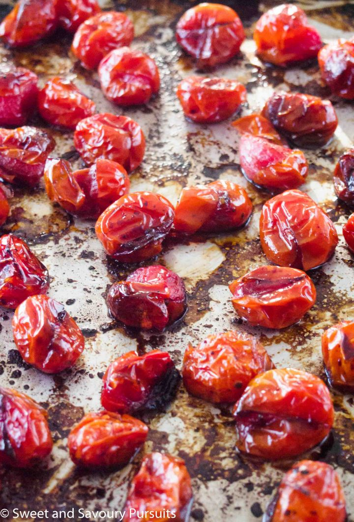 Roasted caramelized tomatoes on baking tray.