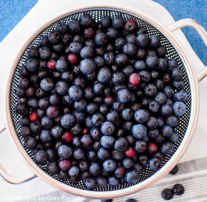 Rinsed blueberries in colander.