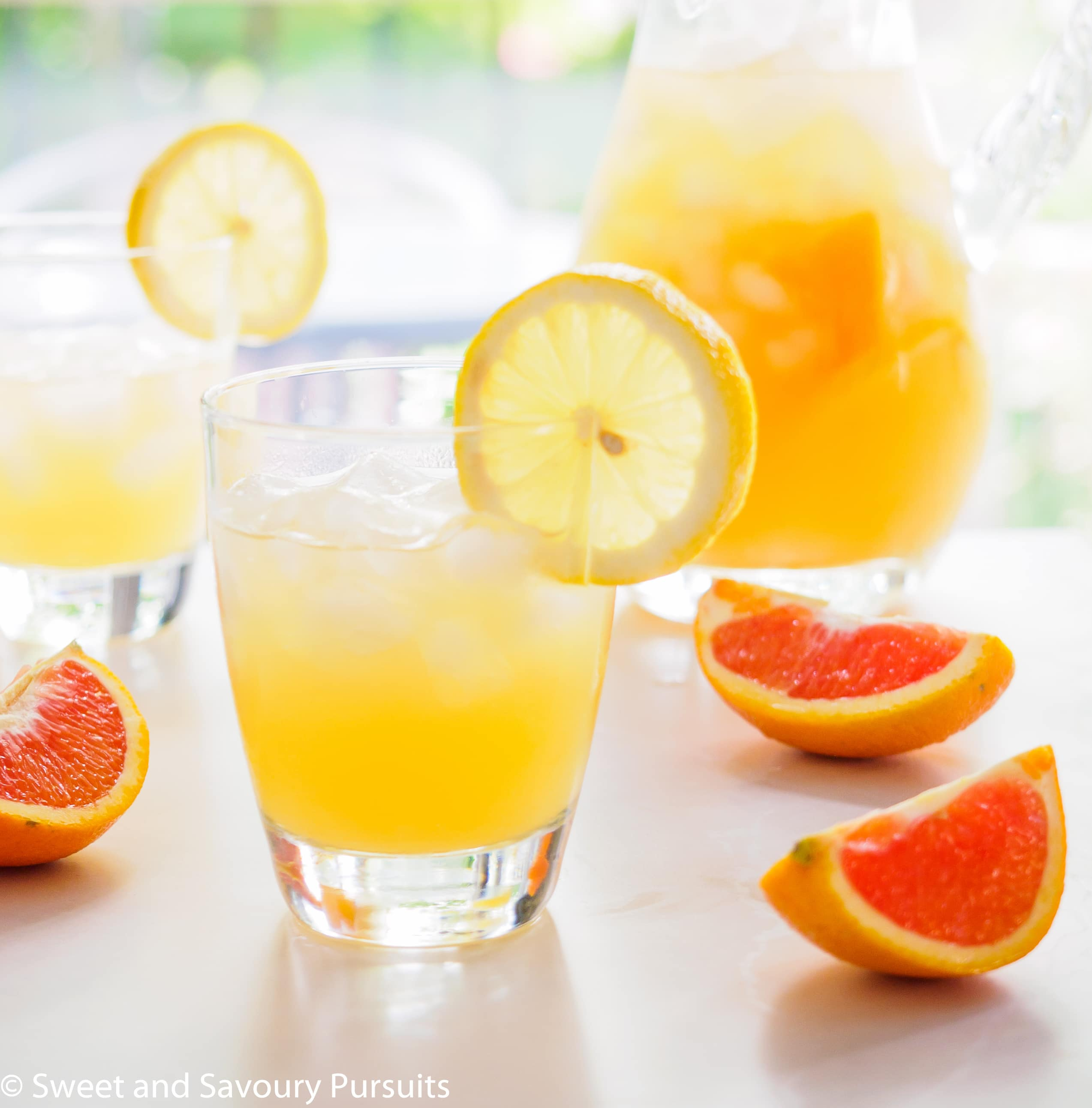 Cara Cara Orange and Citrus Drink poured into glasses.