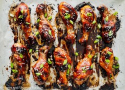 Sticky Chicken Drumsticks on baking tray.