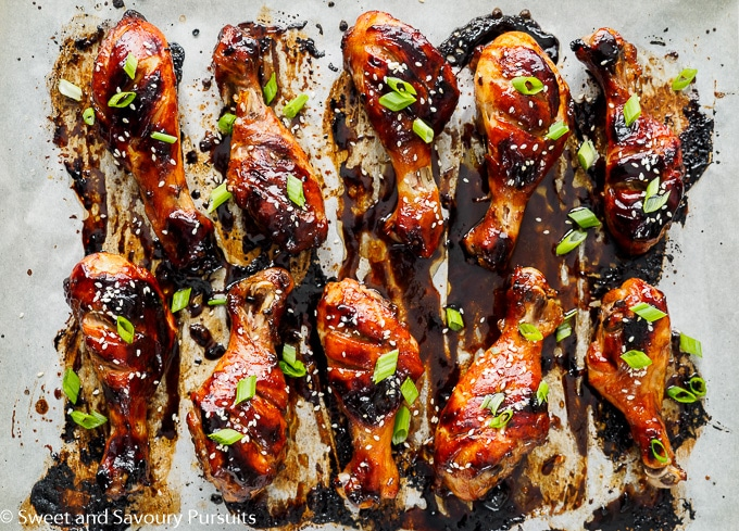 Sticky Chicken Drumsticks on baking tray.