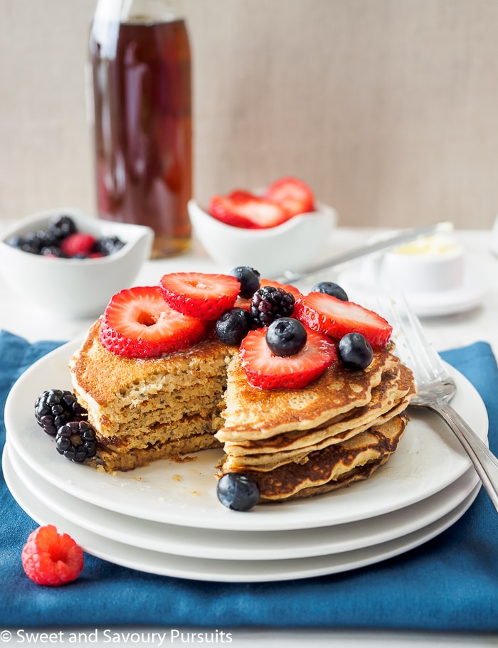 Whole Wheat Quinoa Flour Pancakes with mixed berries on top.