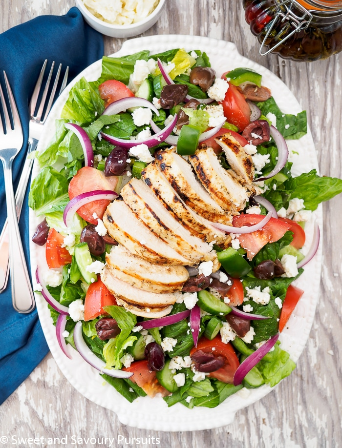 Simple, fresh and flavourful ingredients make this Greek salad with Grilled Chicken one you'll want to make over and over again!