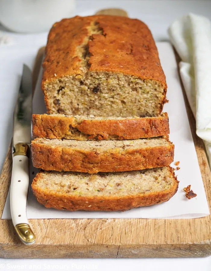 Cut Lemon Zucchini Walnut Loaf on board.