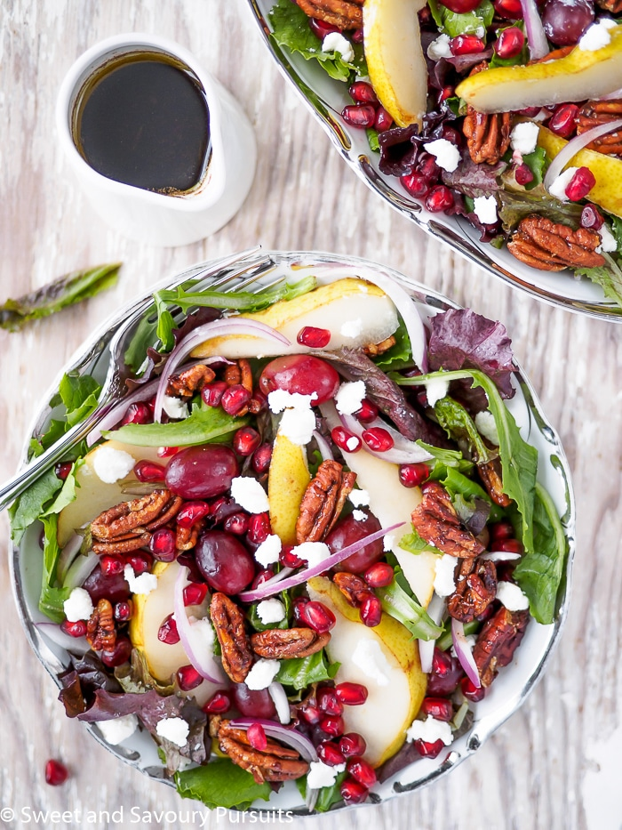 Pomegranate, Pear, Pecan Salad served with a balsamic vinaigrette.