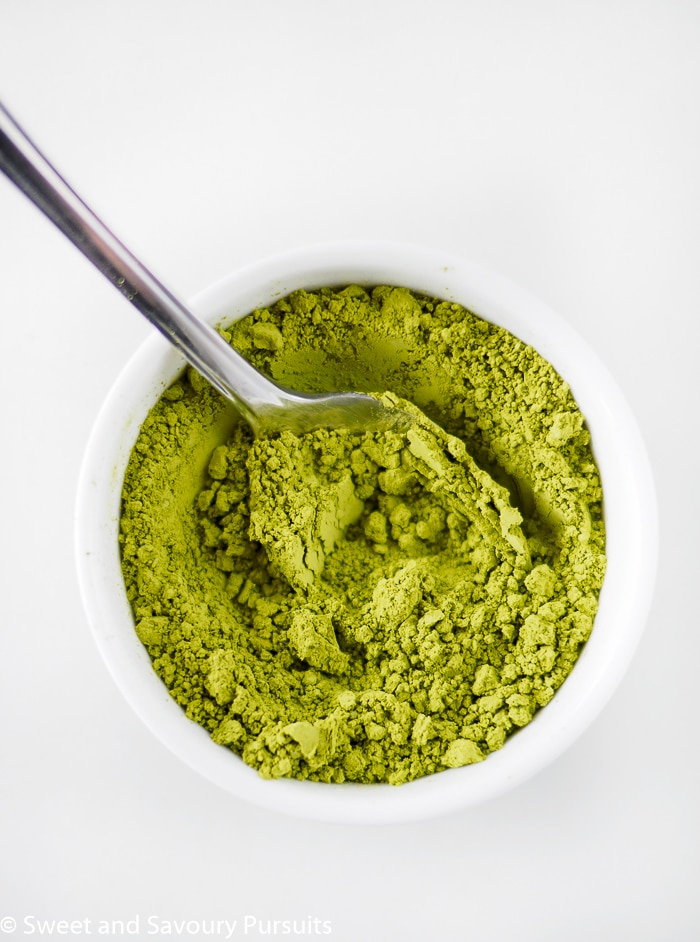 Matcha powder in small bowl.
