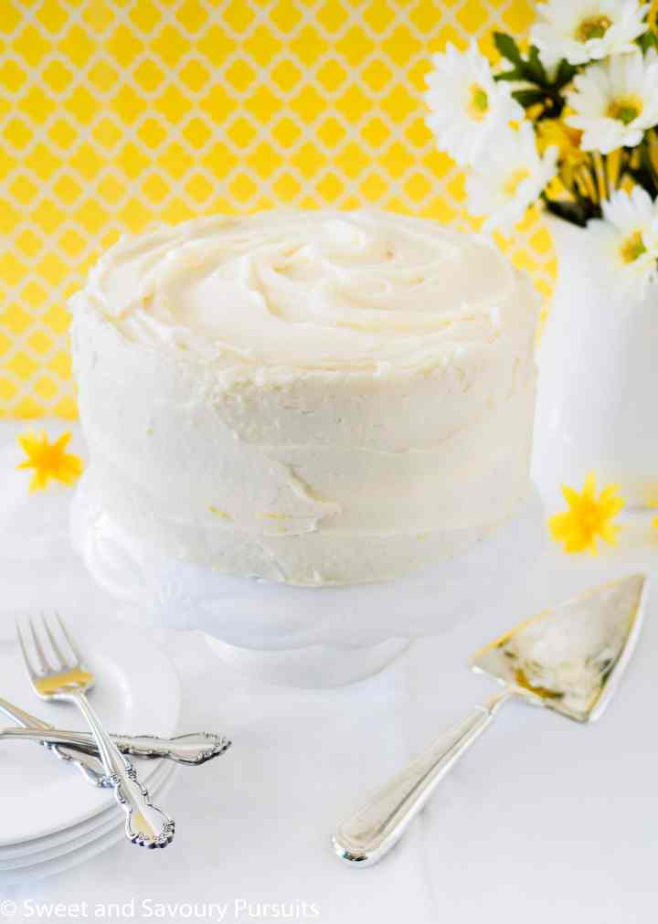 A layered Lemon Poppy Seed Cake frosted with a lemon infused Cream Cheese Frosting