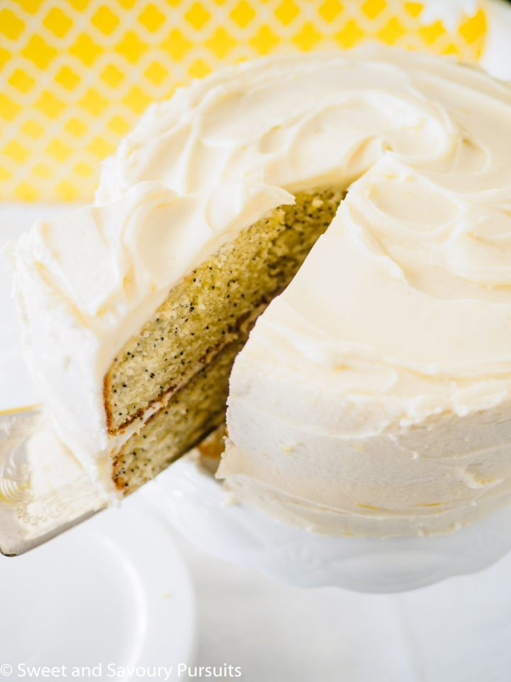 A close-up of a lemon flavoured cake with cream cheese frosting