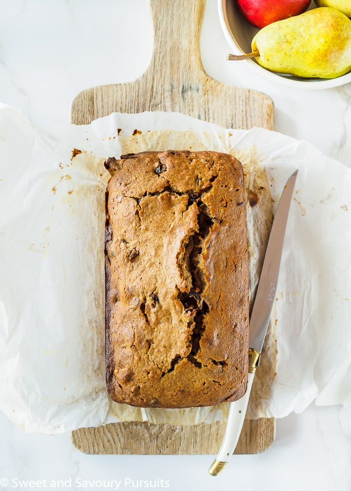 This delicious and easy to make spiced Pear, Date and Walnut Loaf is studded with sweet dates and crunchy walnuts. Enjoy a slice for as a snack or dessert!