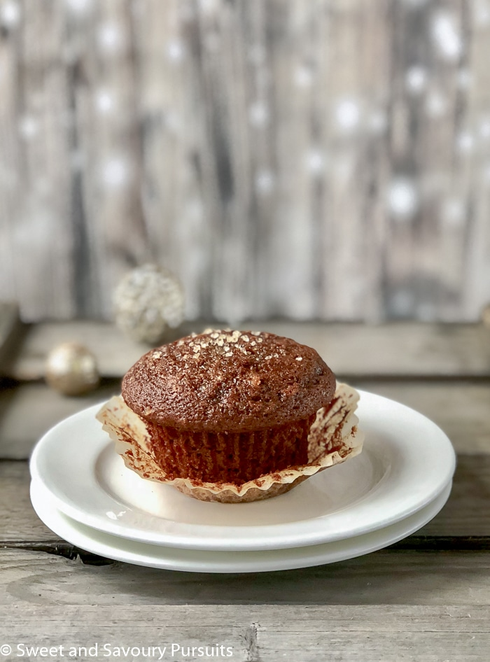 Gingerbread muffin on dish.