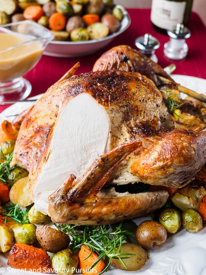 Roasting a turkey need not be a stressful affair, all it takes are a few simple steps and some basic aromatic ingredients for a delicious and flavourful Easy Roast Turkey with Gravy.