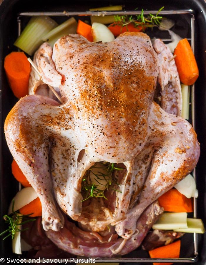 Raw seasoned turkey ready to be roasted.