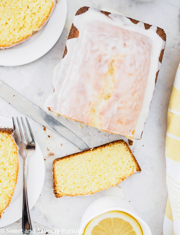 Top view of a Glazed Lemon Loaf Cake that has been cut and plated.