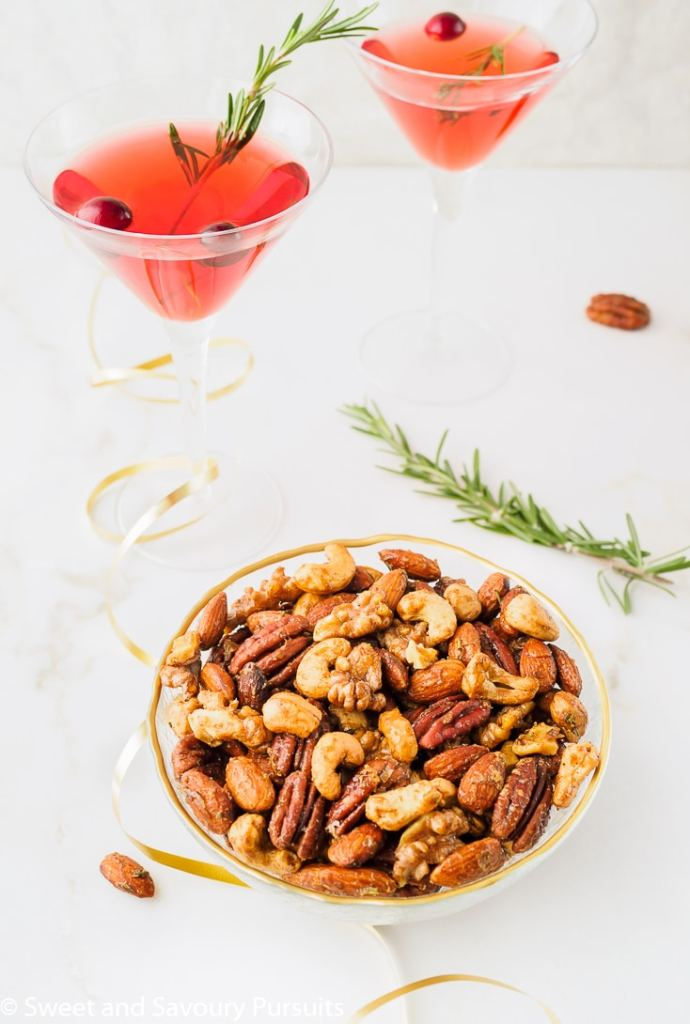 Bowl of Mixed Spiced Nuts served with cocktails.