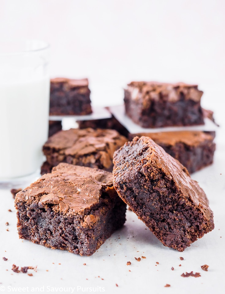 Sliced Gluten-Free Almond Flour Brownies with glass of milk.
