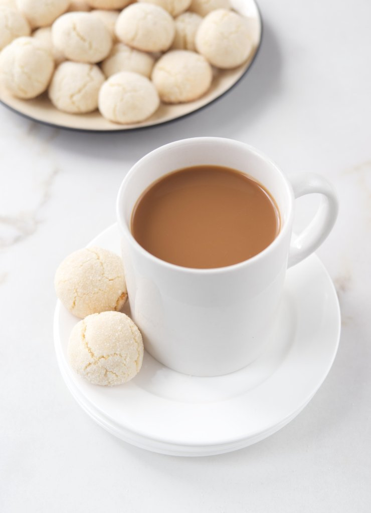 Cup of coffee with amaretti cookies.