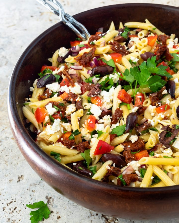 Mediterranean Pasta Salad in a large wooden bowl.