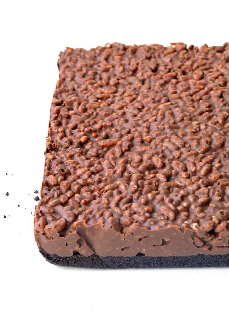 Peanut butter rice krispie bar on a white background