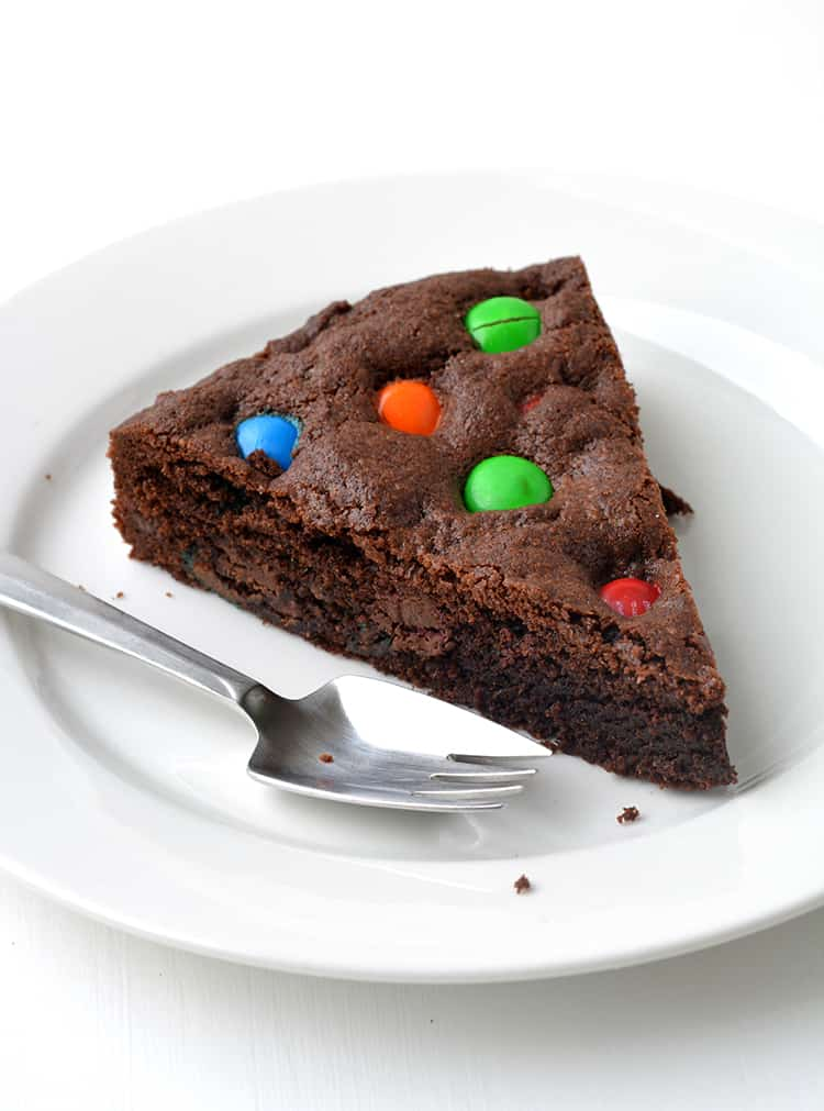 M&M Chocolate Cookie Cake on a white plate