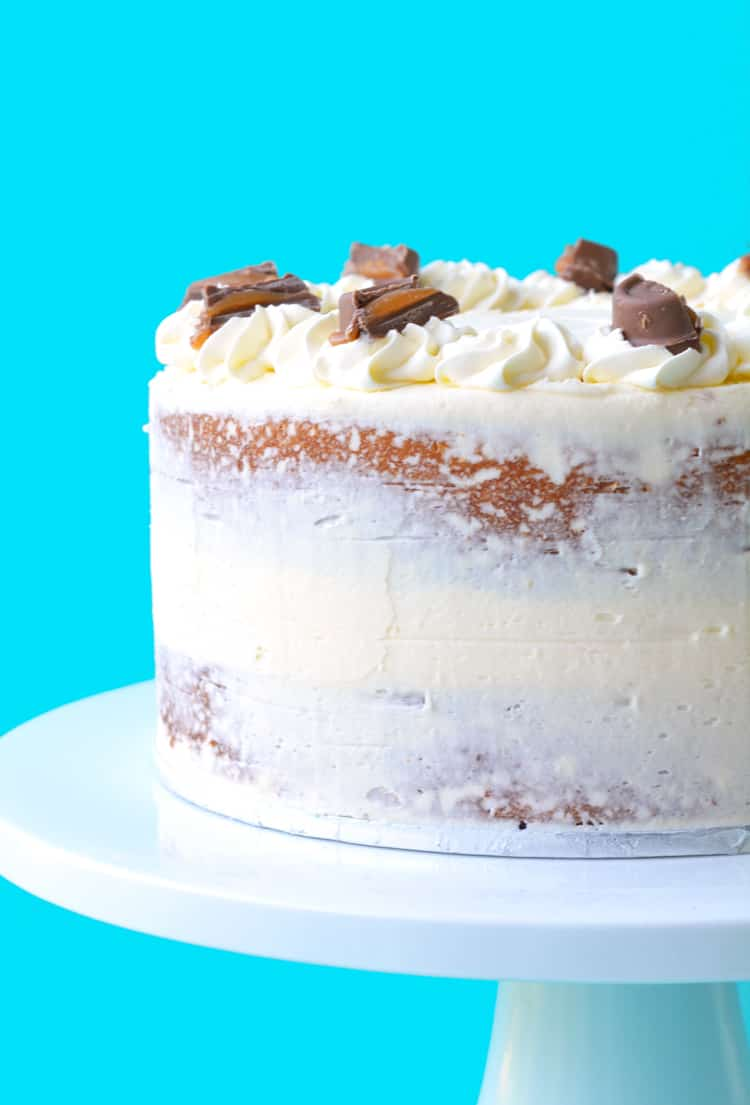 A beautiful two layer Caramel Mud Cake on a white cake stand