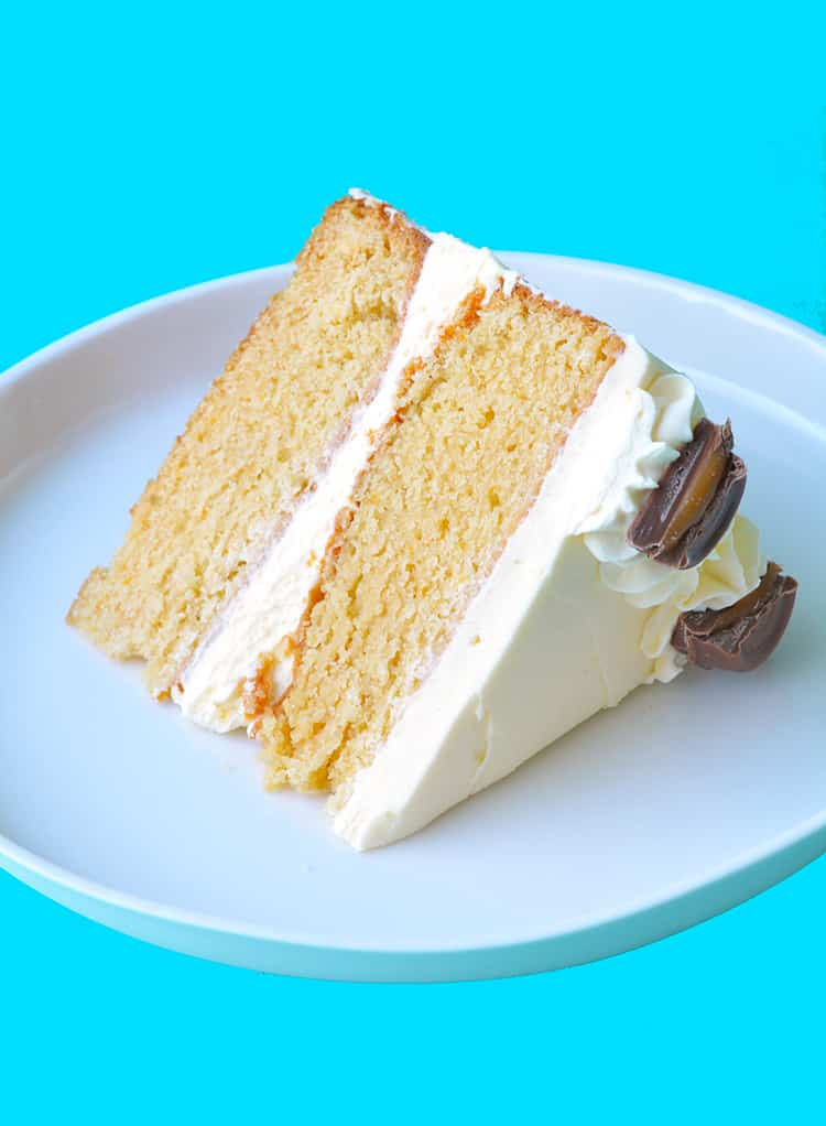 A slice of two layer Caramel Mud Cake on a white plate
