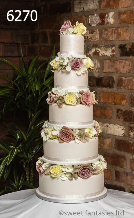 silk flowers for wedding cakes uk wedding cake designs with flowers sweet fantasies cakes 19837