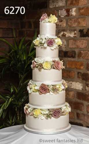 5 tier round wedding cake with fresh & silk flowers