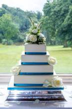 4 Tier square wedding cake with fresh flowers. By sweet fantasies, Stoke-on-Trent