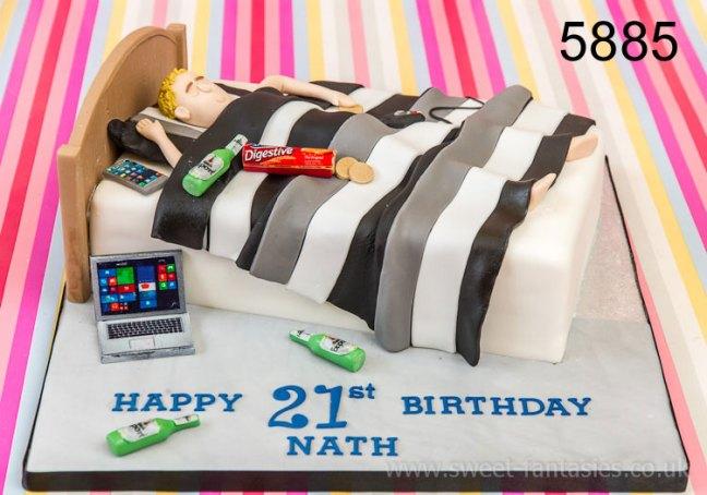 Boy in bed, boys 21st birthday cake