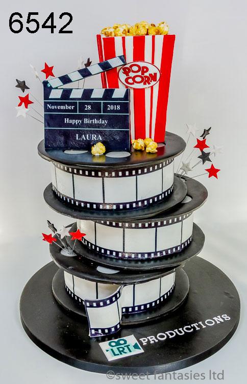 girls film making themed birthday cake