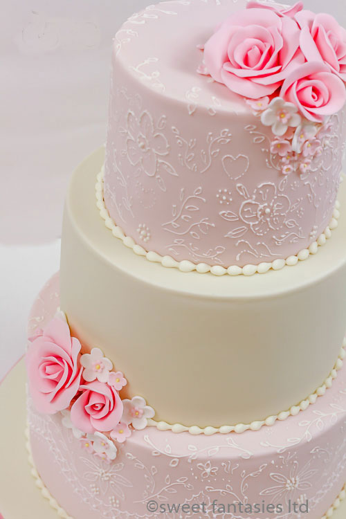Pale pink & cream wedding cake with pink roses