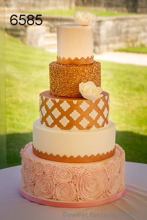 5 tier pink & copper colour wedding cake