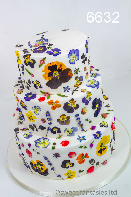 Wedding cake with edible pressed flowers