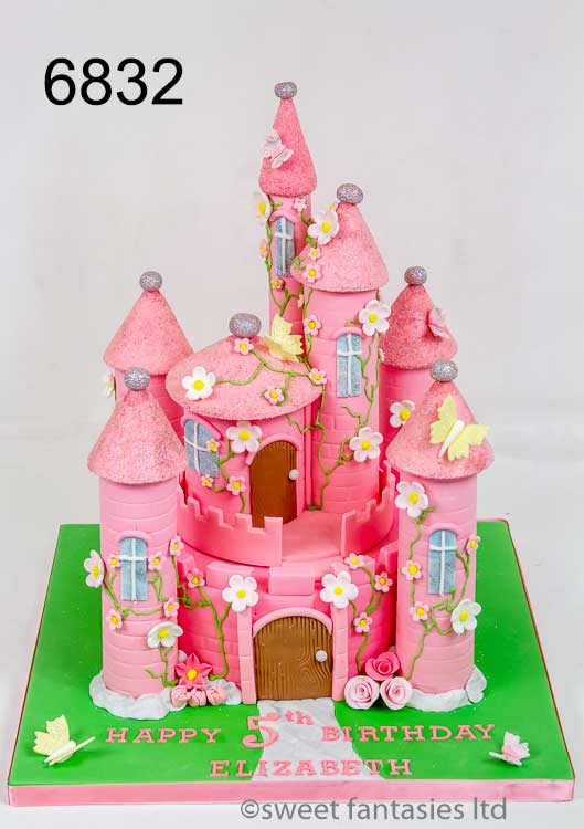 pink castle cake with flowers & butterflies