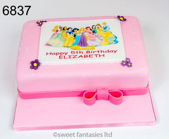 Girls birthday cake with picture of Disney Princesses