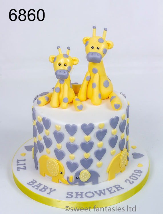 baby shower cake with giraffes & elephants