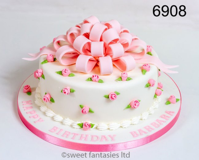 Birthday cake with small pink roses & pink bow on top