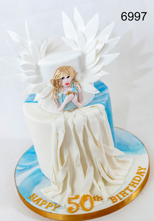 2 tier ladies birthday cake with angel at the front