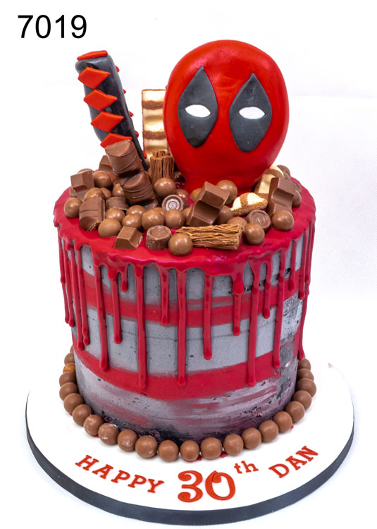 30th Red drip cake with chocolates